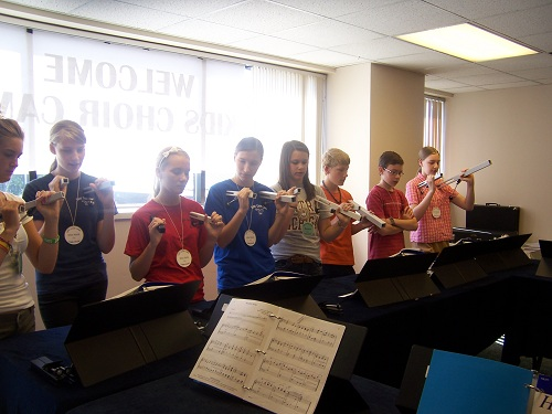The Alumni Teen Choir rehearses. Fifth and sixth grades also learn choir chimes.